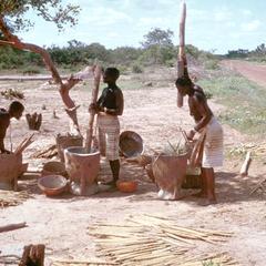 Women Pounding Millet Along Roadside