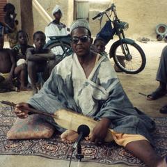 Yaya Banbera Performing a Bamana Epic with His Ngoni at Family Compound