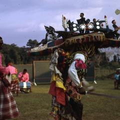 Men perform during the Arugu masquerade.