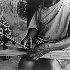 Close-up of Man Making Fish Trap