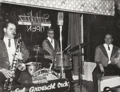 Syl Groeschl plays saxophone with his orchestra