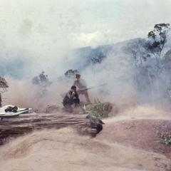 Military officer firing weapon