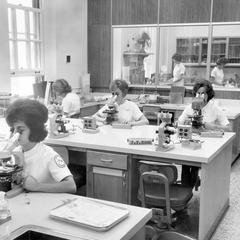 Women Using Microscopes