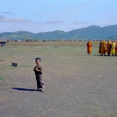 Young girl and monks in landing area