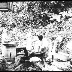 Women washing at spring