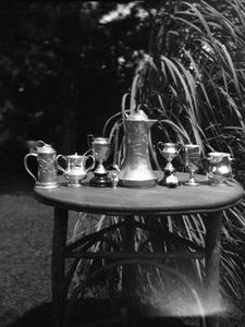 Silverware and trophies sitting on table outside
