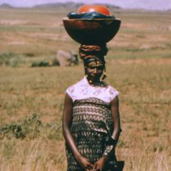 Fulani girl with pottery