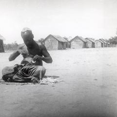 Kuba-Bushong Man Making Thread Using Big Toe