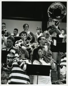 Stout Pep Band playing in the bleachers at a men's basketball game
