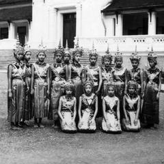 Formal portrait of the royal dancers outside of the Royal Palace