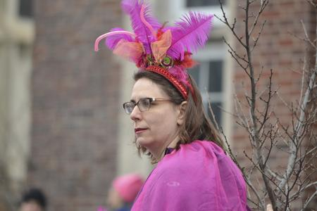 Person in pink feather hat