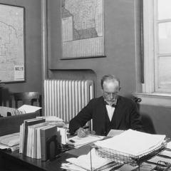 William Lighty at desk