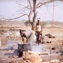 Women Tending Fire Under a Basin for Salt Extraction