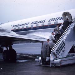 Boarding Scandinavian Airlines System plane