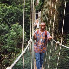 Men on rope bridge in Kakum National Park