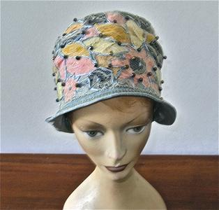 Helmet cloche made of blue shimmery fabric