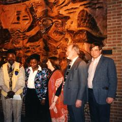 Agbo Folarin with Lillian Trager and Dick Ammann  in front of his mural at UW-Parkside