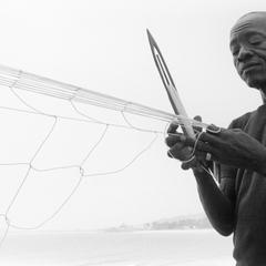 Man Making Net for Ocean Fishing