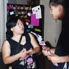 Ann Pham talks to a student