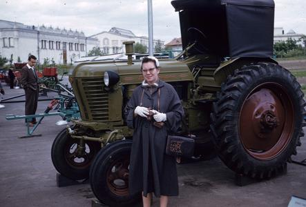 Woman standing with a tractor