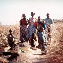 Women Carrying Basins of Dirt to Make Salt