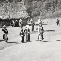 White Hmong youth playing catch ball in Houa Khong Province