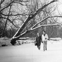 Starker and Betty walking on slough in winter