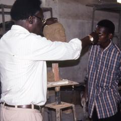 Agbo Folarin with student