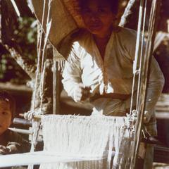 A White Lahu (Lahu Hpu) woman weaves in the village of Chalopha in Houa Khong Province