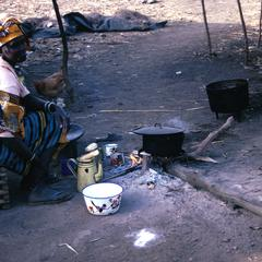 Woman Using Firewood to Cook a Meal