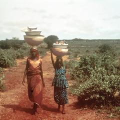 Fulbe Mother and Daughter Bringing Dairy Products to Town to Sell