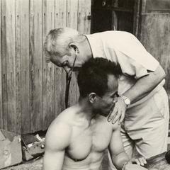 Kong Le is examined by an American physician