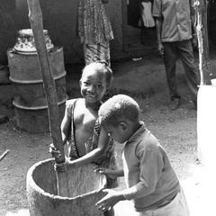 Children Playing with Mortar and Pestle