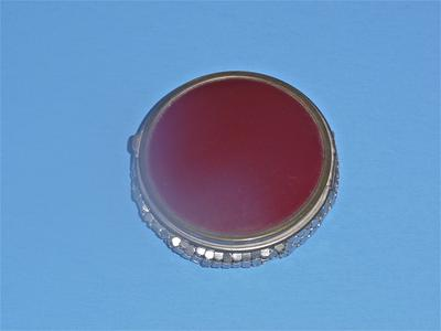 Round compact with a maroon enameled lid