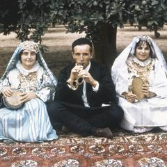Posed Portrait of Two Libyan Women and Man Seated in Clothing of Rural Tradition