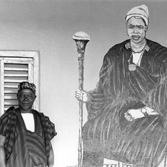 A Paramount Chief Next to His Coronation Portrait