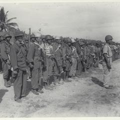 Guerrillas stand in formation on beach, Masbate, 1945