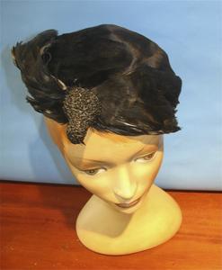 Black velvet hat with bird