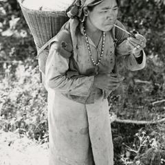 A Nyaheun woman walks along a path in Attapu Province