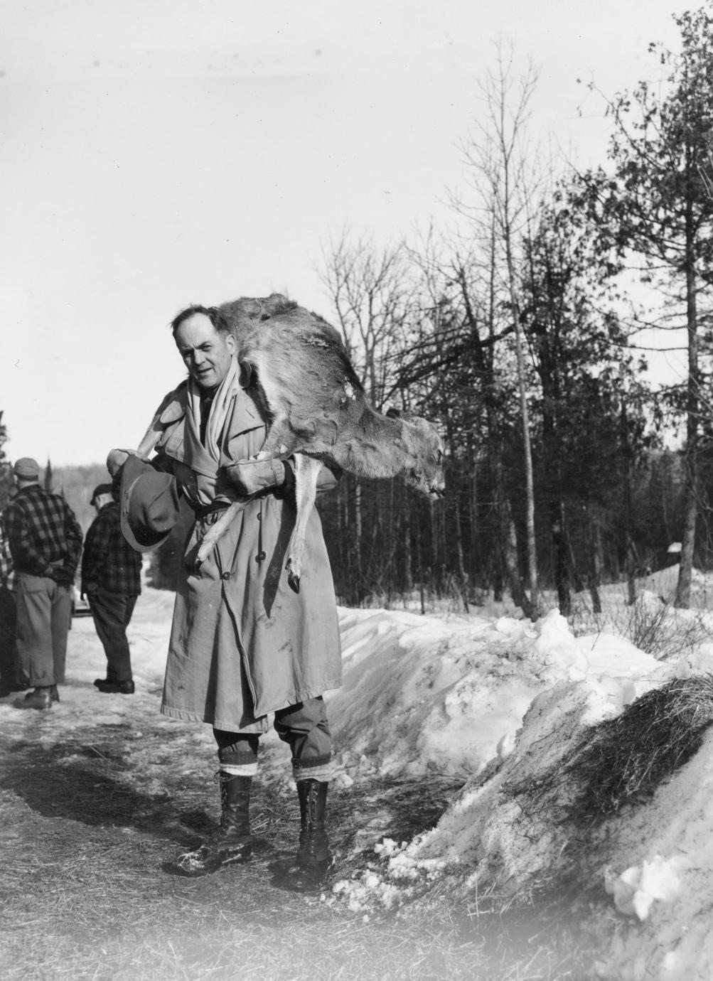 Larry Whiffen carrying deer