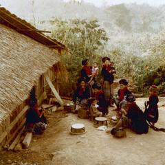 Yao (Iu Mien) women gathered in front of a dwelling in Houa Khong Province