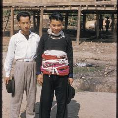 Two Hmong (Meo) men (one in Hmong (Meo) dress)