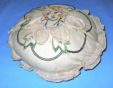 Round cream-colored organdy pillow