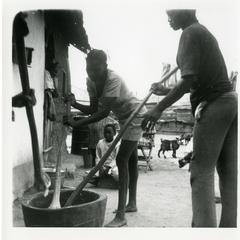Pounding yams for market