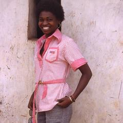 Nike (Komolafe) Afolabi against building
