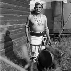 Ho-Chunk man with drum