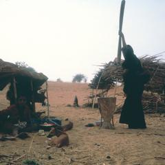 Tuareg Woman Pounding Millet at an Isolated Homestead in Central Niger