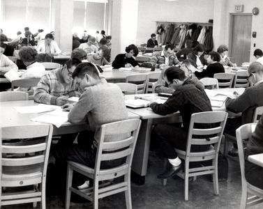 Students study in Commerce building