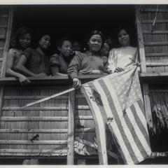 Filipino family shows U.S. flag, 1944