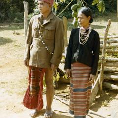Nyaheun husband and wife stand in traditional clothing in Attapu Province